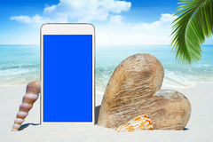 White Smartphone and wooden Heart Stock Images