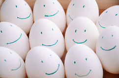 White smile eggs in tray horizontal. On the full backgrpound close-up royalty free stock images