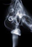 White smoke on black Stock Photos