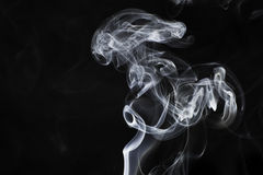 White Smoke on Black. Background Royalty Free Stock Photography
