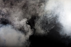 White smoke on black background royalty free stock photo