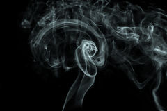 White smoke on black background. Abstract white smoke on black background stock image