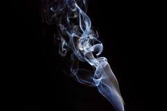 White smoke on a black background Royalty Free Stock Photos