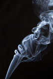 White smoke on black background. Stock Images