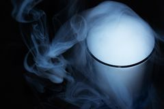 White smoke on black fabric background in glass. Smoke spreads over the background. Vaping culture, life without cigarettes. stock images
