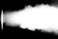 White smoke in light beam Royalty Free Stock Images