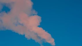 White smoke in the blue sky. Closeup Stock Images