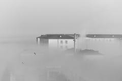 White smoke building. White  from the chimney smokes knocks the sky black and smoke building Royalty Free Stock Photo