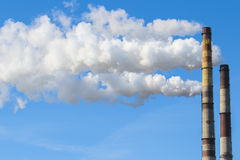 White smoke from chimney  Royalty Free Stock Photography