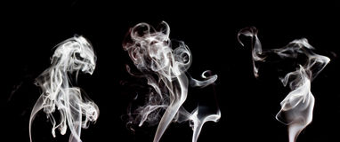 White smoke colection, isolated on black background. Set of three different smoke, easy to edit Royalty Free Stock Photography