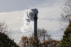 White smoke comes out of chimney royalty free stock photography