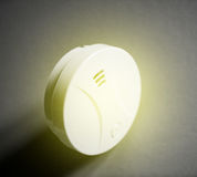 White smoke detector on table yellow waves Royalty Free Stock Photography