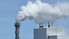 White smoke from factory plant over blue sky background. stock footage