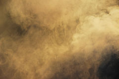 White smoke from the fire where wet boards and sawdust lie. Royalty Free Stock Photo