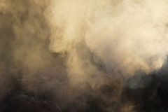 White smoke from the fire where wet boards and sawdust lie. Stock Photography