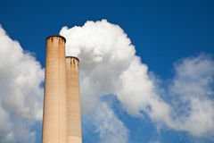 White Smoke out of Industrial smokestack Royalty Free Stock Image