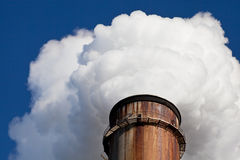 White Smoke out of Industrial smokestack. White Smoke out of rusty Industrial smokestack Royalty Free Stock Photography