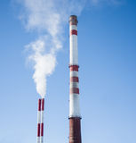 White Smoke out of Industrial smokestack Stock Photos
