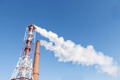 White smoke from pipes against the background of the sky stock photo