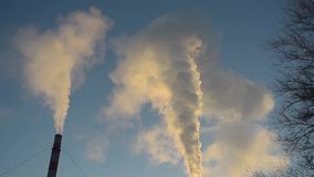 White smoke from pipes against blue sky, production of energy and air pollution stock video footage