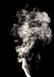 White smoke swirls. Abstract white smoke swirls over the black background Stock Photos