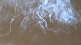 White smoke swirls through the air stock video footage
