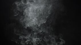 4k video of vapor cloud. White smoky cloud of electronic cigarette on black background stock footage
