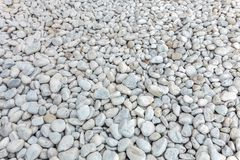 Pebbles texture, beach rocks many stock images