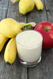 White smoothie made with apple, banana and pear. On wooden board Royalty Free Stock Photo
