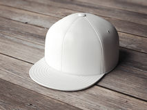 White snapback on the wooden floor. 3d rendering Stock Photos