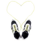 White sneakers with heart on white Stock Images