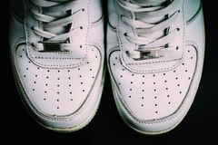 White Sneakers isolated on black background stock photo