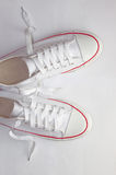 White sneakers. Isolated footwear background Stock Images