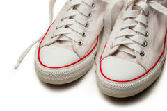 White sneakers. Isolated footwear background Royalty Free Stock Photo