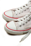 White sneakers. Isolated footwear background Stock Photos