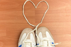 White sneakers in love Royalty Free Stock Photos