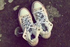 White Sneakers On Asphalt Stock Photo