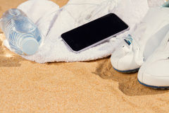 White sneakers in sand Royalty Free Stock Photography