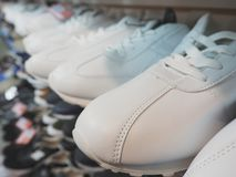 White sneakers on the shelves. White sneakers on the shelves Royalty Free Stock Images