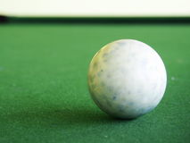 White snooker ball on a table. White snooker ball on a green billiards table royalty free stock photography