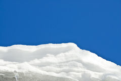 White Snow Against the Blue Sky Royalty Free Stock Images