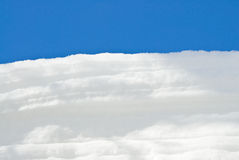 White Snow Against the Blue Sky Stock Photography
