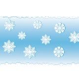White snow on a blue background. Royalty Free Stock Photos