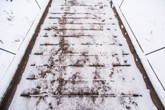 White snow on the boards of the wooden bridge. Winter background for design Royalty Free Stock Photography