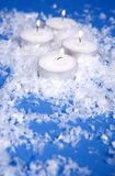 White snow and candles Stock Photos