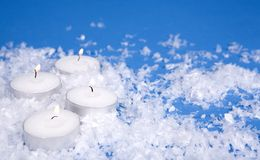 White snow and candles Royalty Free Stock Images