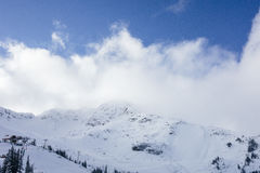 White Snow Coated Mountain during Daytime Royalty Free Stock Images