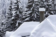 White snow cover on roof top of house and chimney Stock Photos