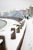 White snow coverd the guardrail of seaside Stock Photos