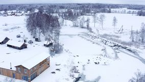 The white snow covering the ground in the village in Estonia. During the winter season stock video footage